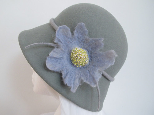 Pale grey cloche hat with blue beaded felt flower