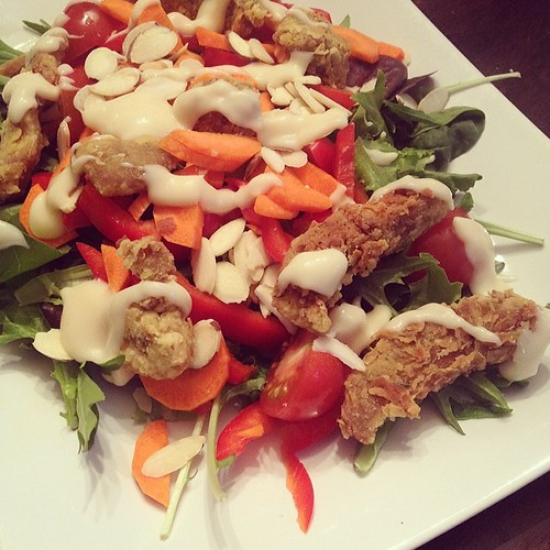 Dinner: fried seitan salad with agave mustard dressing. Carrots, red pepper, tomatoes, slivered almonds. #vegan