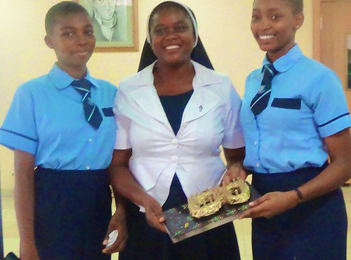 School Principal Gertrude Elelegu SSL receiving a special award from the Marywood Girls School students as a show of their appreciation of her as part of the celebrations at the school for World Labour Day held on May 1 2015