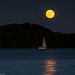 moonlight reflection and sailboat