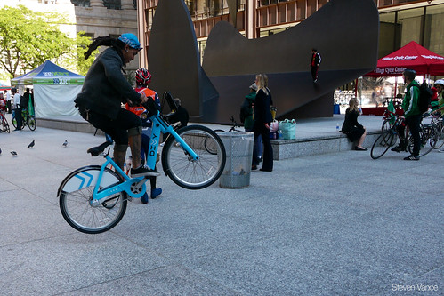 doing tricks on Divvy at Bike to Work Day Rally