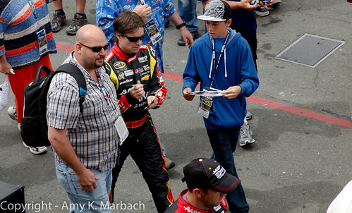 Jeff Gordon signs for fans in the garage