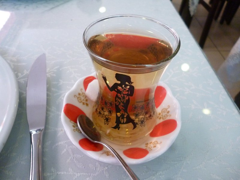 Apple tea served in traditional glass