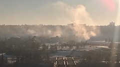 Steam rises over the Muttart Conservatory