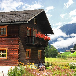 Charming Tyrolean wooden cottage decorated with flowers