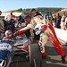 Herschel Walker fist-bumps Mario Andretti after his 2-seater ride
