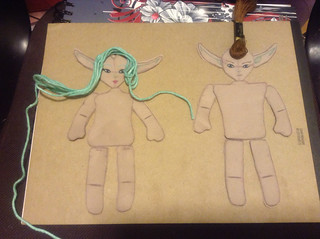 Dolls cut out, painted and ready to be sewn and stuffed.