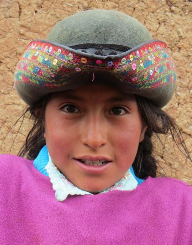 A shy chica, wearing a Chuschi hat