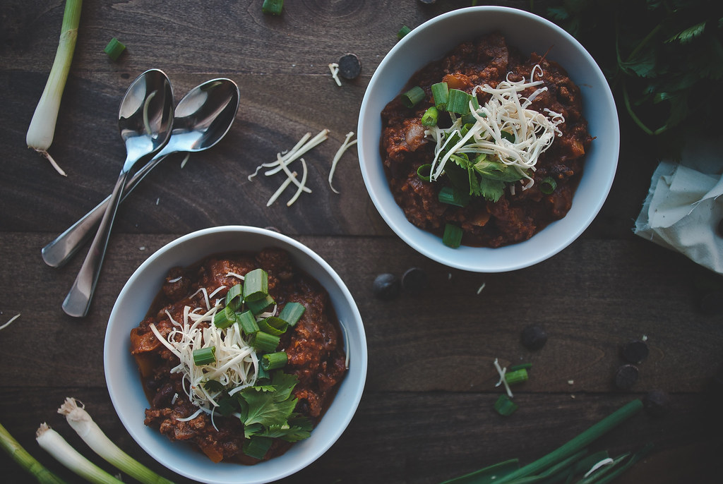 Dark chocolate beef chili with a polar vortex on top. - Two Red Bowls