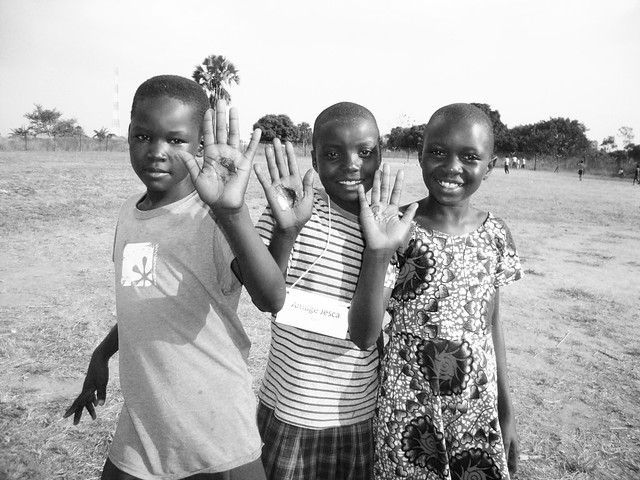 Ugandan kids holding homemade soap in the palm of their hands