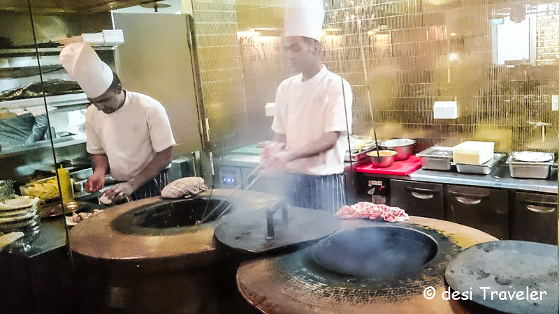 Chef Working on Tandoor in Singapore Punjab Grill