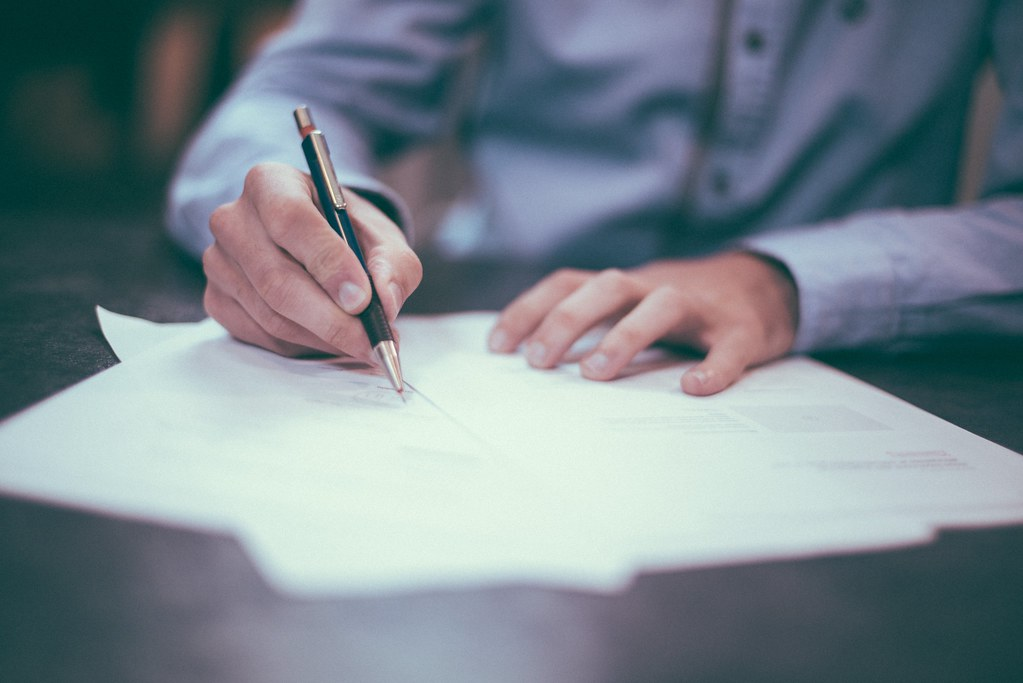 Writing Contract Business Relation - Credit to informedmag.com