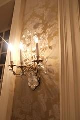 floor(0.0), wood(0.0), ceiling(0.0), chandelier(0.0), flooring(0.0), wall(1.0), light fixture(1.0), room(1.0), interior design(1.0), design(1.0), wallpaper(1.0), lighting(1.0),