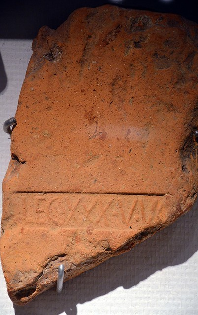 Roof tile stamp with the sign of the Legio XXX Ulpia Victrix found at the ancient site of Forum Hadriani, Rijksmuseum van Oudheden, Leiden