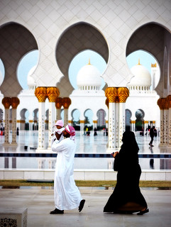 Arab family walking around Sheik Zayed Grand Mosque, Abu Dhabi