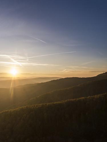 sunset sun sky blue forrest wood horizon daylight landscape nature clouds zagreb sljeme croatia moment canon g15