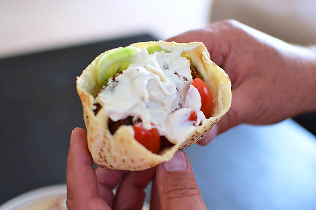 Serve Authentic falafel recipe in pita bread with chopped salad and tahini yogurt sauce.