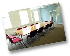 well lit room with boardroom layout for 12 people