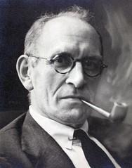 Sam D. Heron Smoking a Pipe