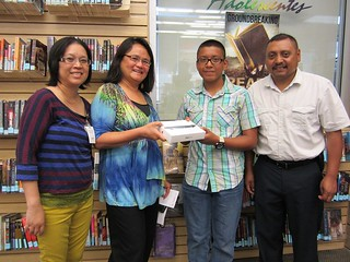 Carmelo Barrera with Father and Library Staff