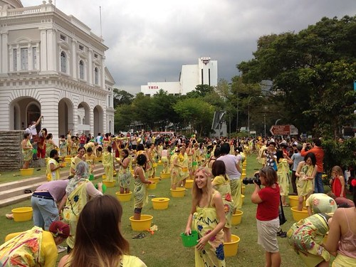 Singapore Biennale 2013. Singapore Biennale 2013 Mandi Bunga (Flower Bath) in progress at the National Museum front lawn. Courtesy of Kate Horsburgh.