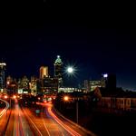 Full Moon Setting Behind Atlanta Skyline
