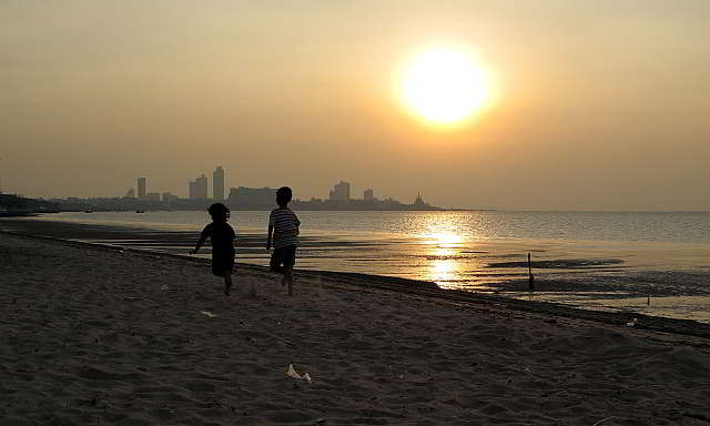 children having fun on the beach in pattaya