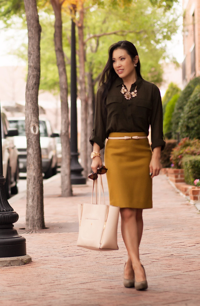 cute & little blog | petite fashion | neutral safari earth tones outfit | army green shirt, mustard pencil skirt, pink bow belt, lily wang statement necklace