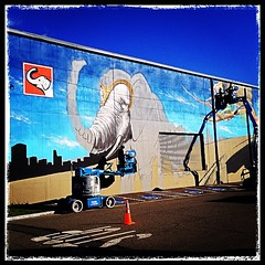 The new mural being painted across the street from my new place.