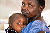 Margareth Steven (right) holds Naomy Zakaria, a two-year-old child with severe malnutrition, at the malnutrition ward in Al Shabbab hospital in Juba, South Sudan.  © Albert Gonzalez Farran, UNICEF
