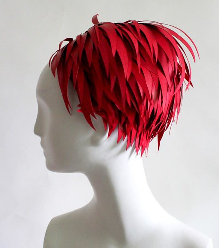 shaggy red paper wig on mannequin's head
