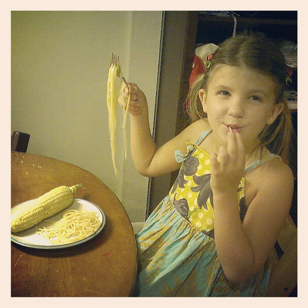 Minor miracle...someone ate pasta and corn on the cob! Parents of extreme picky eaters, take heart! :-)