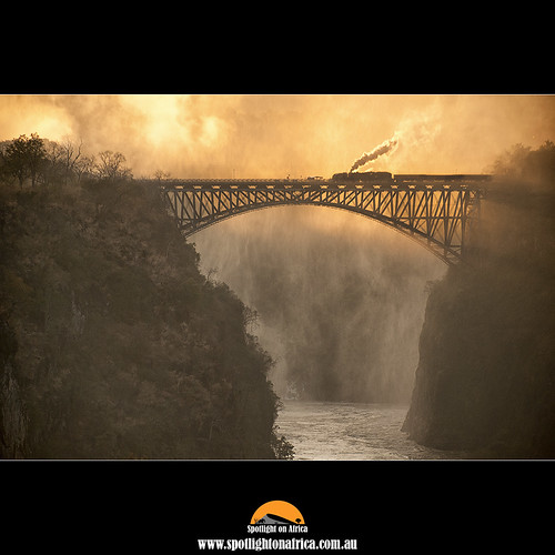 bridge train sunrise waterfall zimbabwe victoriafalls zambia steamtrain malcolmfackender spotlightonafrica