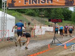 Crossing the finish line together at Muckfest