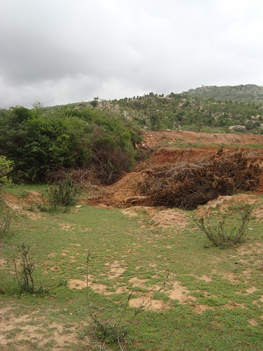 Stream diverted into encroached farmland