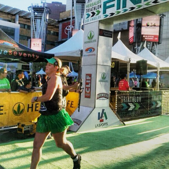 Finish line photo from today's  5K. I was making bee-line straight to the bathroom. Sickness has taken over me today post-race. Cold/Sinus Infection. But I did PR at the race. Win Win! #latriathlon2013 #herbalife5k #teamsparkle #herbalife #racecurse