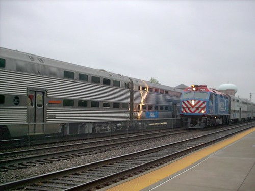 A westbound Metra express passes a local commuter train at the La Grange Road Amtrak / Metra commuter rail station.  La Grange Illinois.  April 2007. by Eddie from Chicago