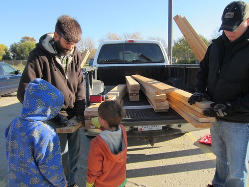 Agricultural research science technician Fred Engstrom (left), a parent volunteer and two Central Elementary students measuring out lumber