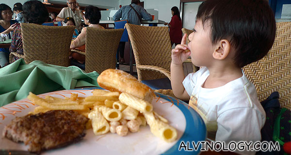 Upon boarding the ship and checking into our stateroom, I brought Asher to Windjammer, the complimentary international buffet restaurant for lunch