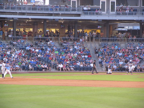 Batter and catcher blend into the crowd at ONEOK Field