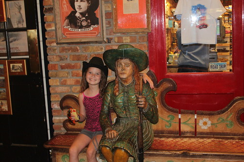 Vali with an Annie Oakley statue at Wall drug