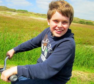 John auf dem Fahrrad