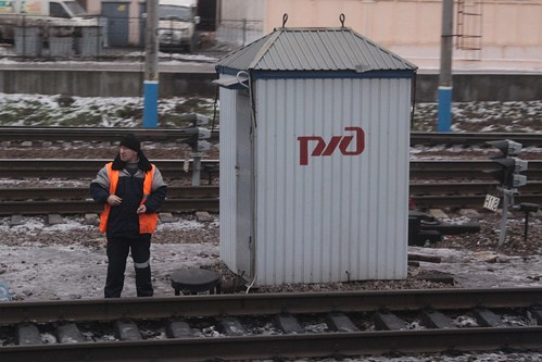 РЖД worker waiting for our train to pass at Липецк (Lipetsk)