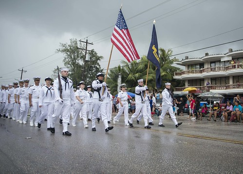 Sailors and midshipmen embarked aboard USS Momsen (DDG 92) march in Saipan's 2013 Liberation Day Parade.