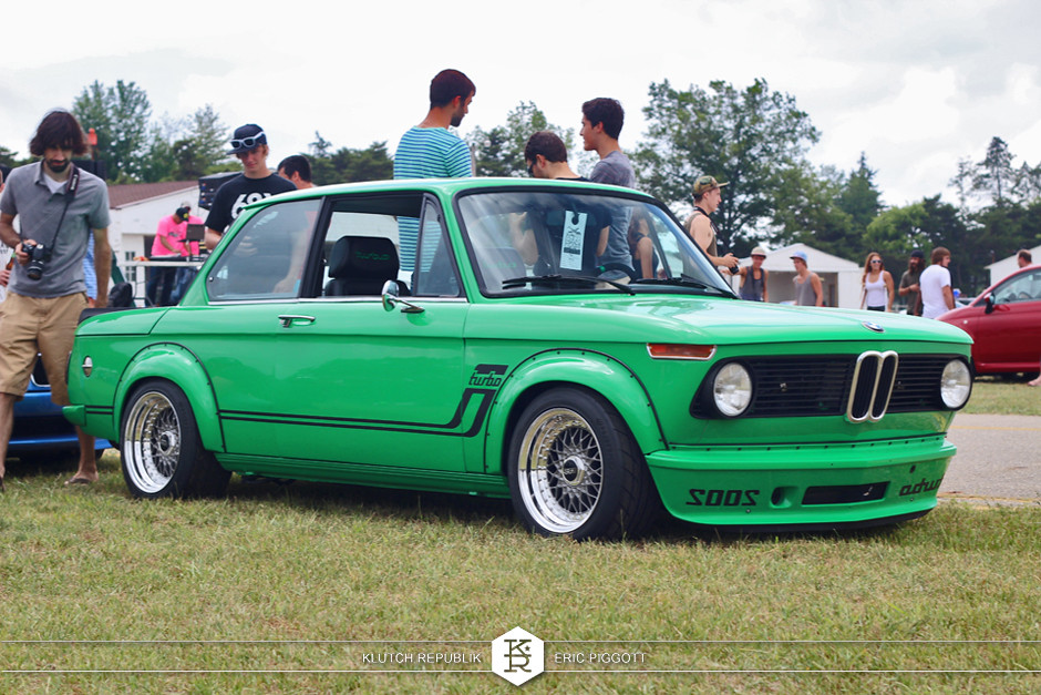 green bmw 2002  at eurohanger 2013 holland michigan slammed dropped dumped bagged static coilovers hella flush stanced stance fitment low lowered lowest camber wheels tucked 16s 17s 18s 19s 20s 3piece 1 piece custom airbags scene scenester