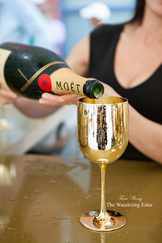 Pouring Moët & Chandon outside at their outdoor bar