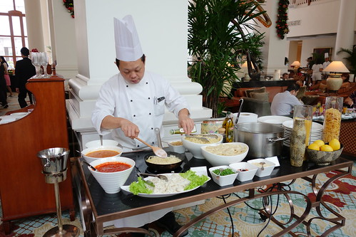 Chef adding some White Truffle Oil to the pasta. Sunday Champagne Brunch. InterContinental Singapore