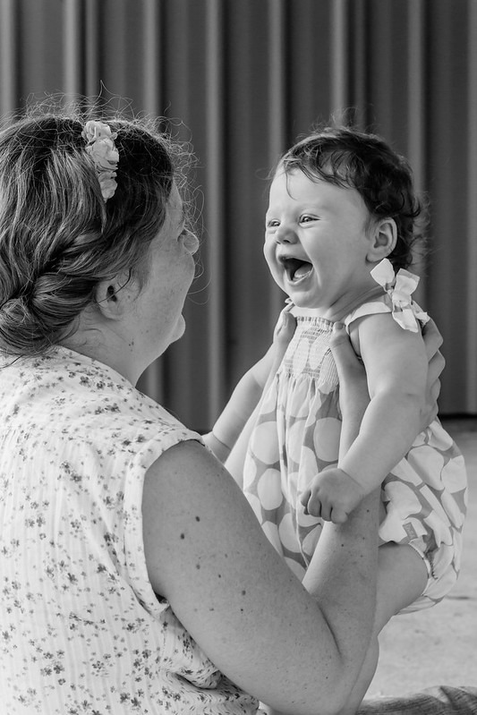 happy baby laughing at mother