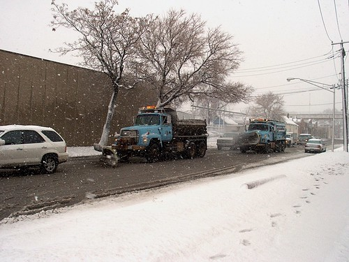 Two City of Chicago Department of Streets and Sanitation snowplow trucks at work during a snowstorm.  Chicago Illinois. December 1st, 2006. by Eddie from Chicago