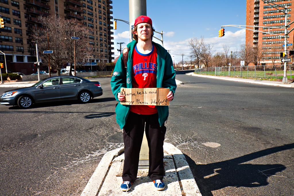 Young-man-panhandling-in-North-Camden-on-4-5-14--Camden